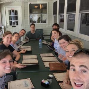 Counselors bonding over lunch in Oriental before camp starts.